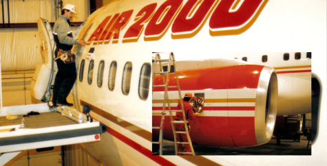 Charlie Halpin President SFX putting graphics on an Air 2000 737 in a hanger in Toronto in 1989.png